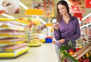 woman checking label for clean foods quality